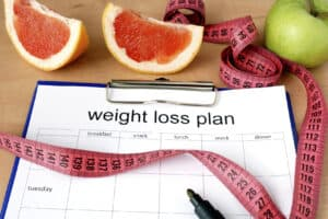 Paper-with-weight-loss-plan-and-grapefruit-000064271367_Medium