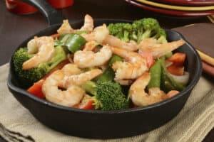 Shrimp stir fry in a cast iron skillet